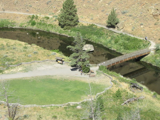 Looking Down at the Walking Bridge Over Crooked River channel that Swirls around the Base of Smith Rock